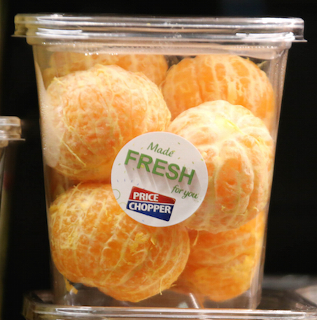 Peeled oranges, repackaged in plastic. Image by Paul Sableman, used via CC BY 2.0.
