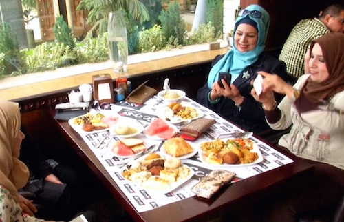 Restaurant patrons enjoy a meal in Baghdad.Image: Business Insider