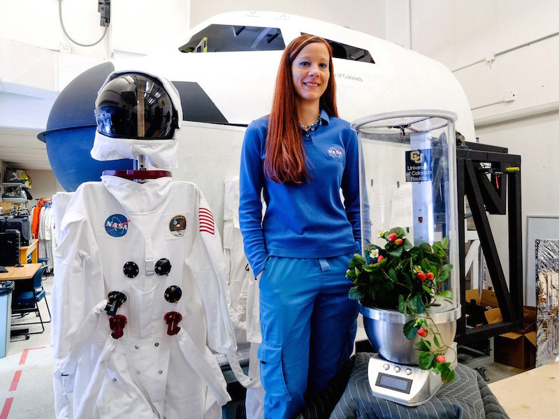 University of Colorado Ph.D. student and NASA Fellow Heather Hava with her robotic gardening system. Image: Alex Pilnick
