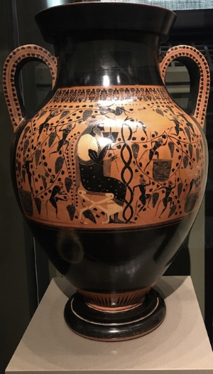 On this amphora, you see Dionysus, the Greek god of the grape harvest and winemaking, drinking wine while satyrs make wine, illustrating the journey from vine to cup.