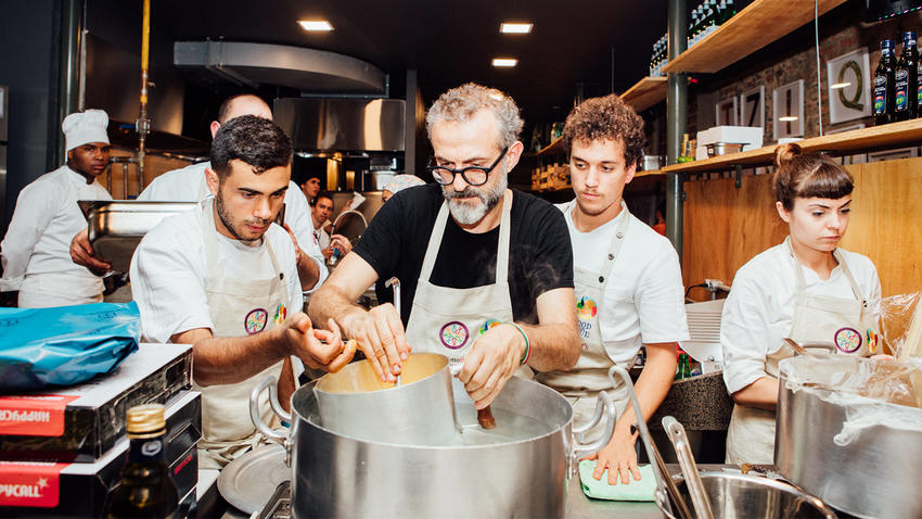 Italian Chef Massimo Bottura created the Refettorio Gastromotiva, a large pop-up soup kitchen that repurposed unused food from the Olympic Village into meals for Rio's poor during the Games.