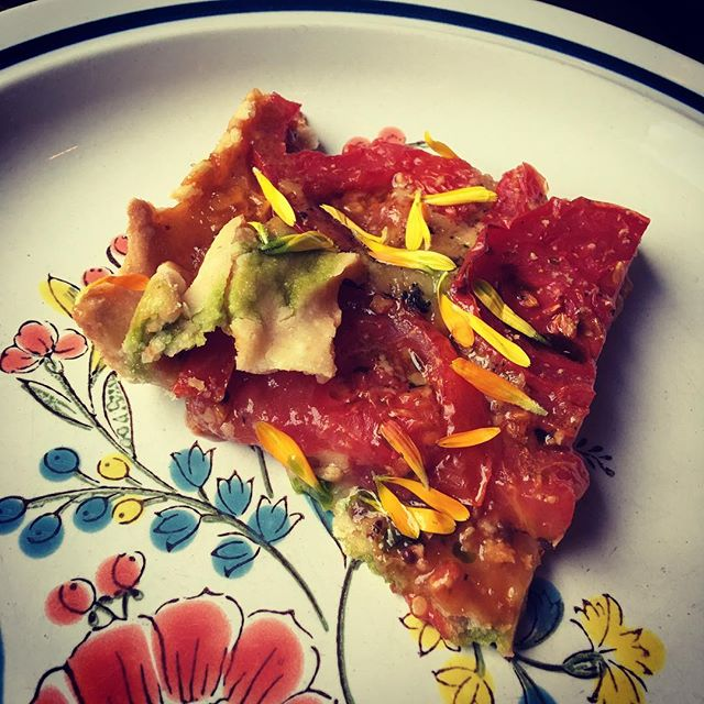 Tomato galette, onion jam, cheddar cheese, basil...