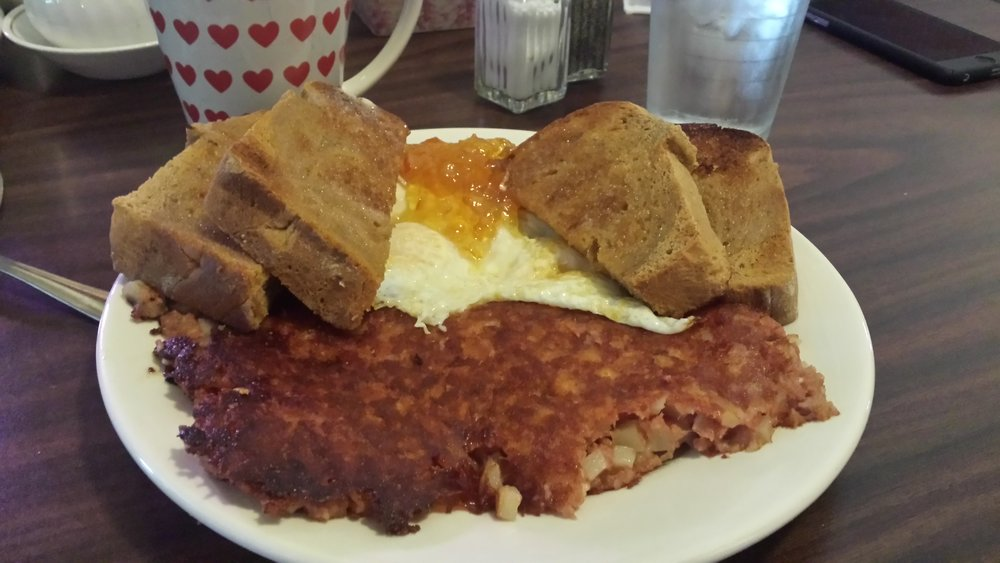Cooked to order corned beef hash, eggs and homemade bread and jam