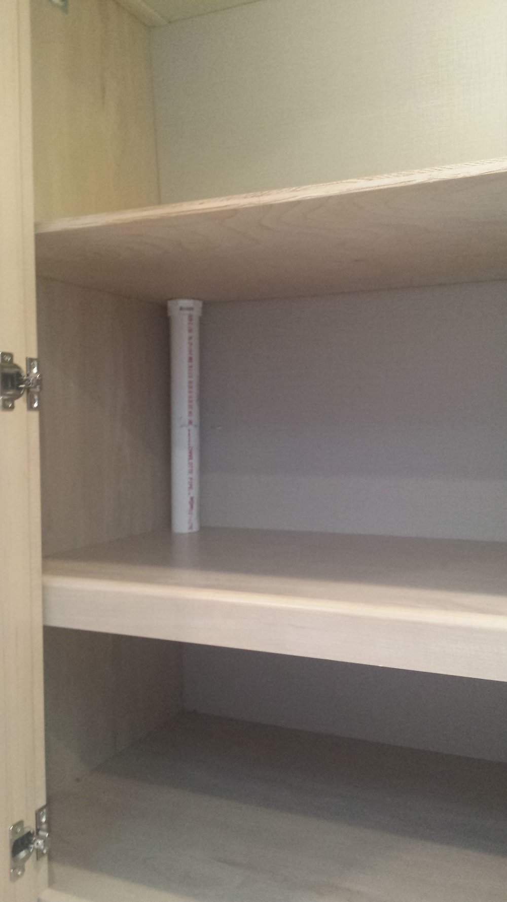 An extra shelf replaces a hanging rod in our small RV wardrobe. when we take long trips.