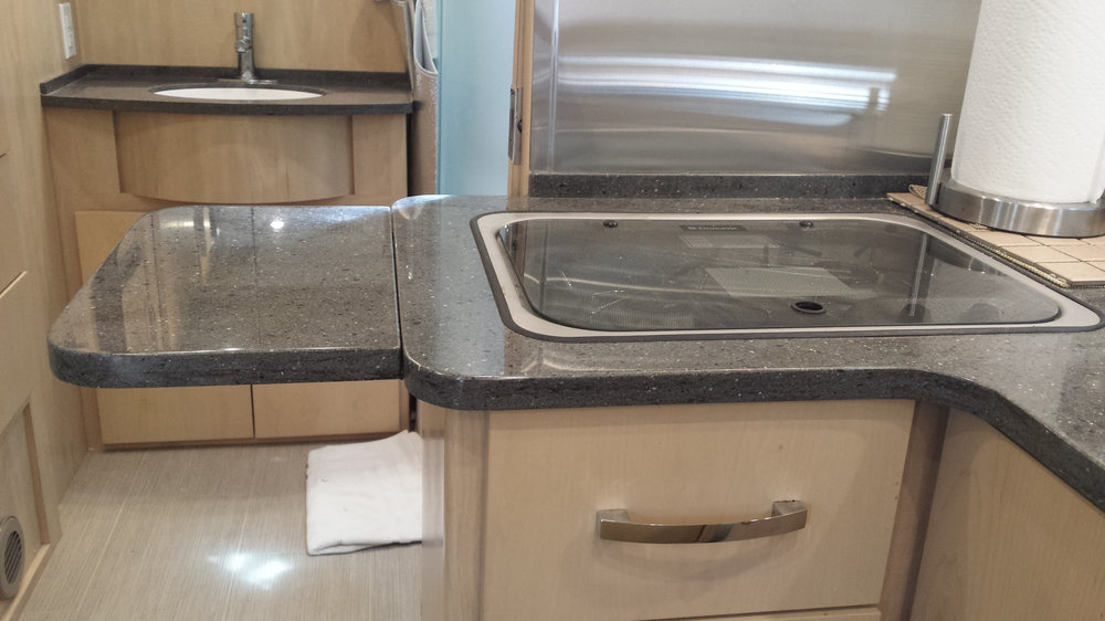 A flip-up counter extension comes in handy in a tiny RV kitchen!
