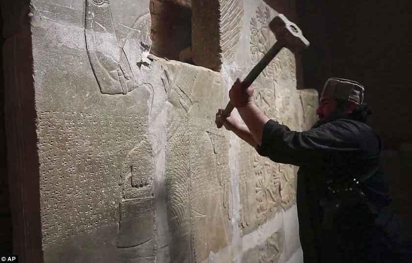 ISIS militants sledgehammering Assyrian bas relief sculptures in the ancient city of Nimrud, present-day Iraq.