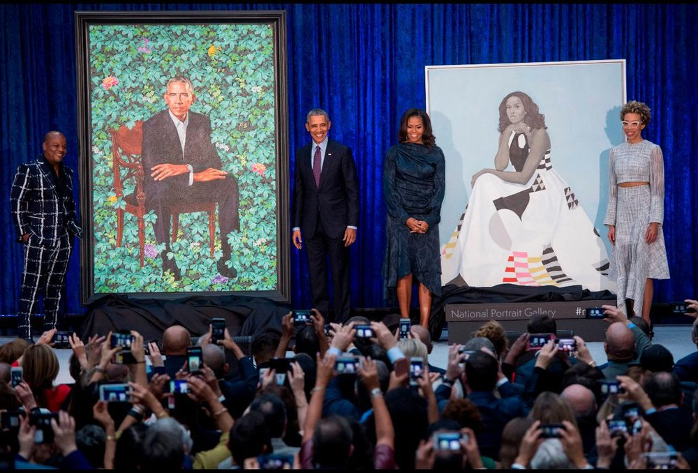 Saul Loeb,  Former US President Barack Obama and First Lady Michelle Obama stand before their portraits and respective artists, Kehinde Wiley (L) and Amy Sherald (R), after an unveiling at the Smithsonian's National Portrait Gallery  ,  12 February 2018. ( http://time.com/5143747/obama-presidential-portrait-kehinde-wiley/ )
