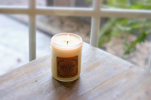 A candle loses nothing by lighting another candle 💛 This tobacco scent candle from @lightshinecandles is our absolute favorite - pick one up from our boutique tomorrow ☀️