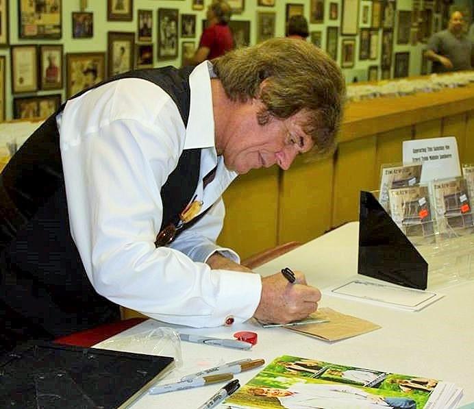 Tim MNJ signing autographs.jpg