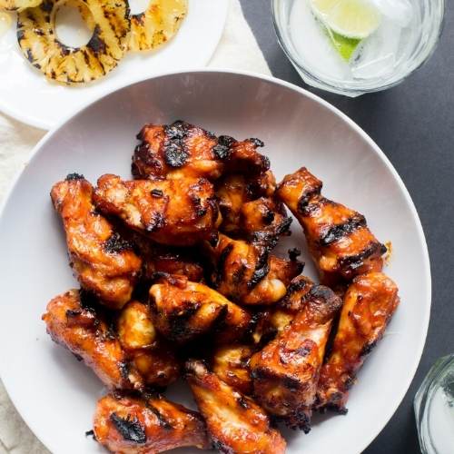 Huli Huli Chicken Wings - [By The Domestic Man]These Hawaiian-style wings are get their sticky sweetness from pineapple and would make a great addition to any summer meal.