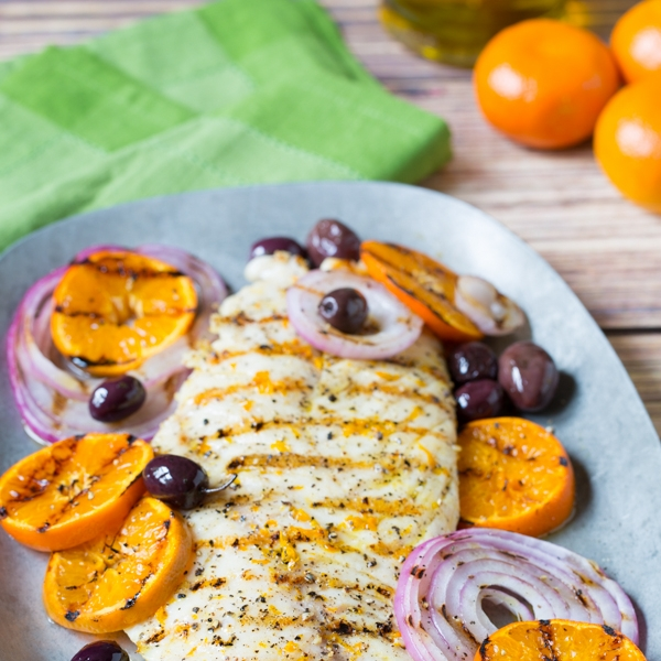 Grilled Grouper With Orange + Olives - [By A Spicy Perspective] This dish has everything you want in a summer meal. Less than 7 ingredients, incredibly easy to throw together, and big bold flavors from sweet oranges, onions, and salty olives.