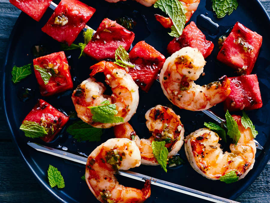 Grilled Watermelon + Shrimp Skewers - [By MyRecipes]I had never even considered grilling watermelon until I found this recipe, but now it's one of my favorite ways to eat it. The grill adds a smoky, charred flavor to the watermelon that pairs perfectly with the shrimp in these delicious skewers.