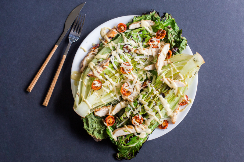 Grilled Romaine Salad - [By The Domestic Man]This salad can be made entirely on the grill, perfect for those warm summer nights when you want to cook everything outside and not mess around in the kitchen.