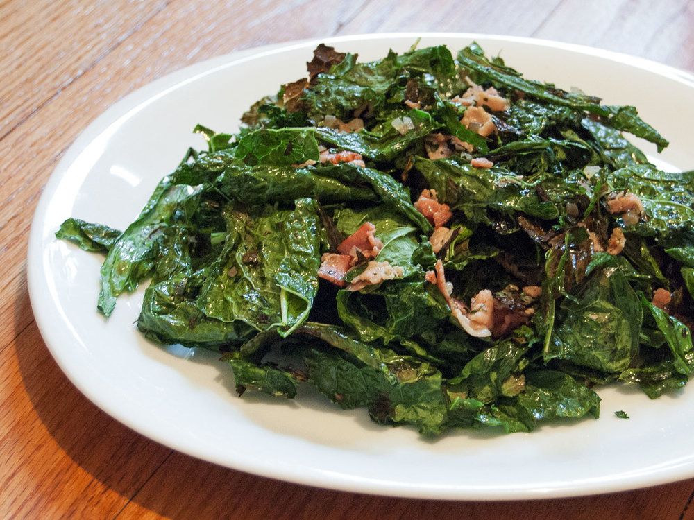 Grilled Kale Salad with Bacon Vinaigrette - [By Serious Eats]What better way to make salad delicious than to put bacon on it? Shallots and apple cider vinegar combine to make a tangy dressing that stands up well to the smoky bacon.