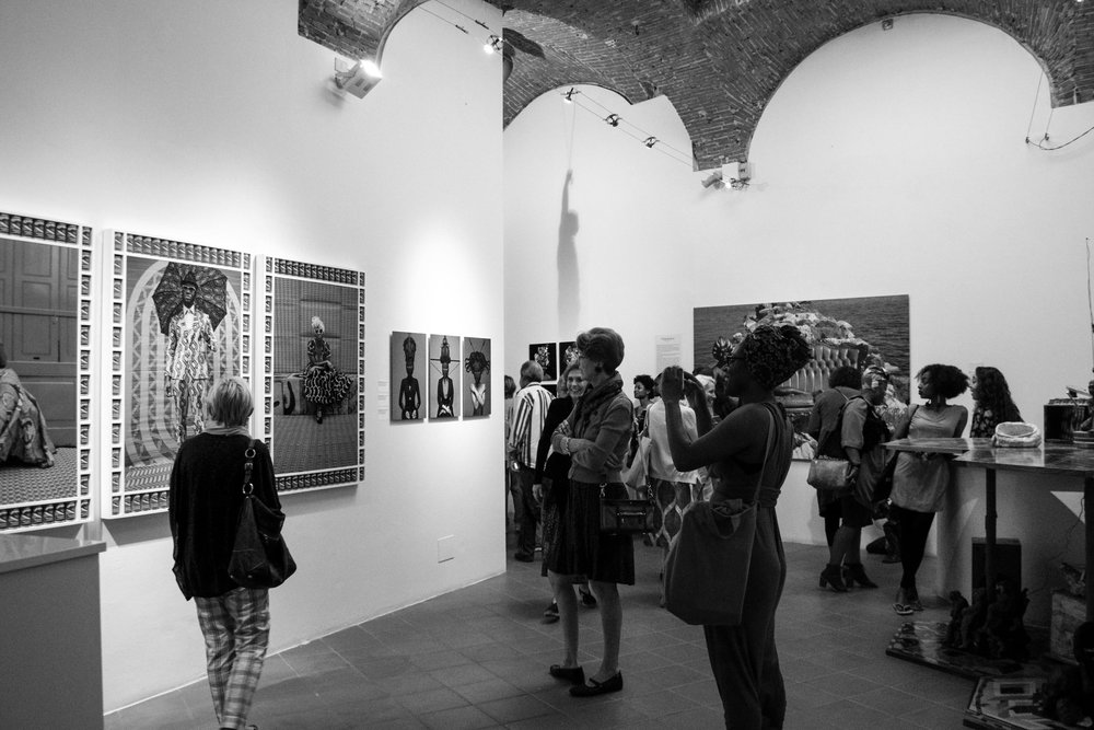 "Visitors attend the opening of ""ReSignifications"" at Biagiotti Progetto Arte in 2015"