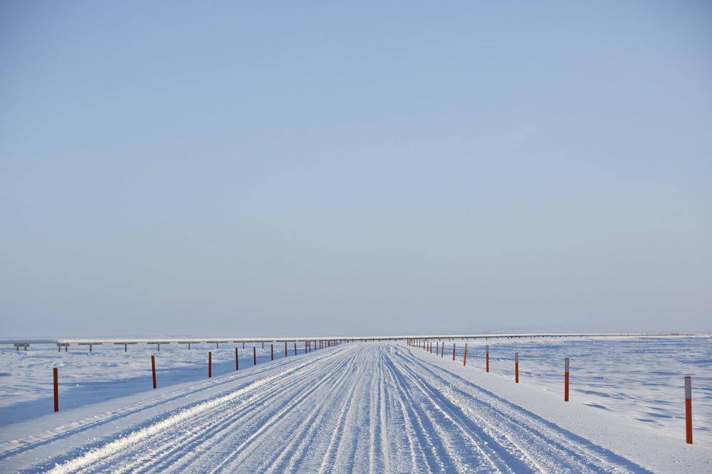 A snow covered road sits on the North Slope in Prudhoe Bay, Alaska, U.S. Photographer: Daniel Acker/Bloomberg