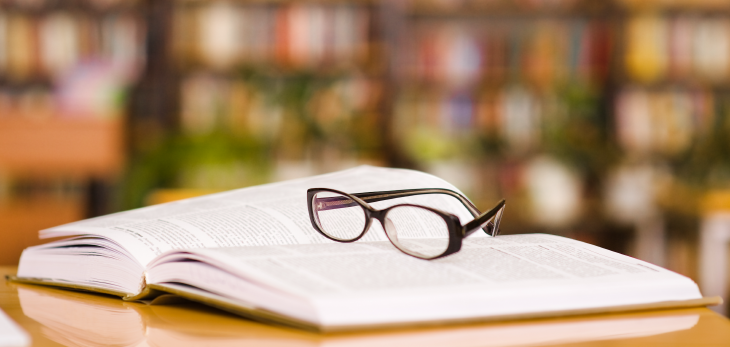 Book and reading glasses. Source: Ermolaev Alexander/Shutterstock.com
