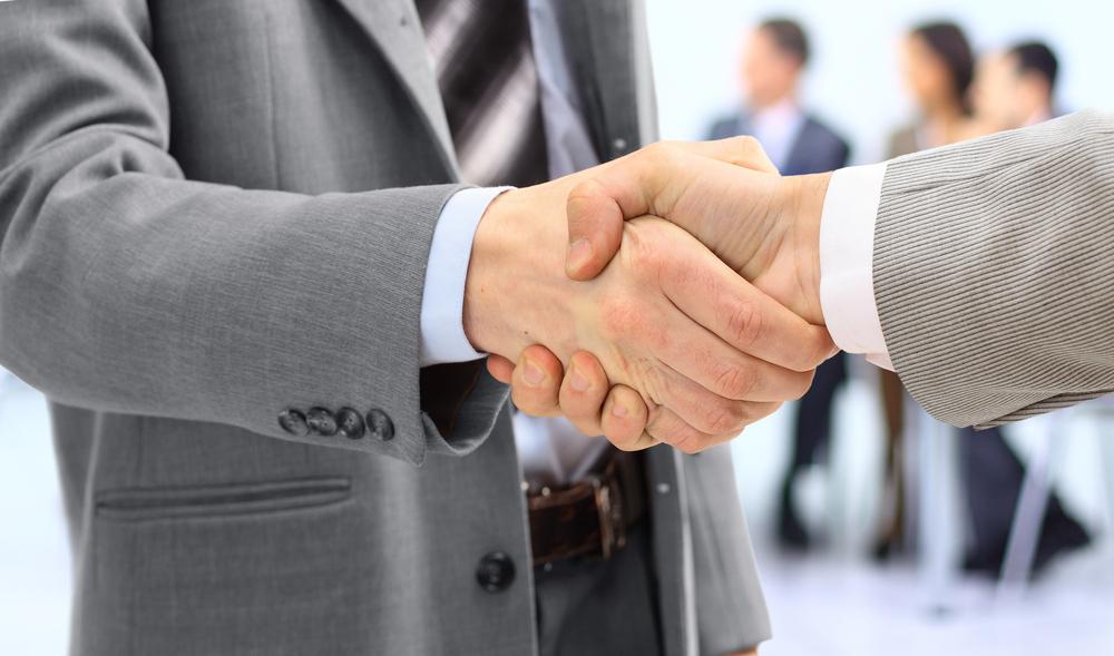 Shaking hands. Source: EDHAR/Shutterstock.com