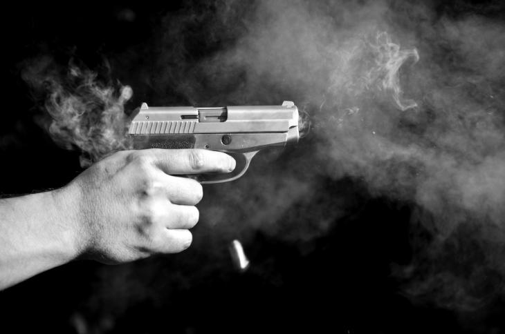 Gun firing. Source: csabacz/Shutterstock.com