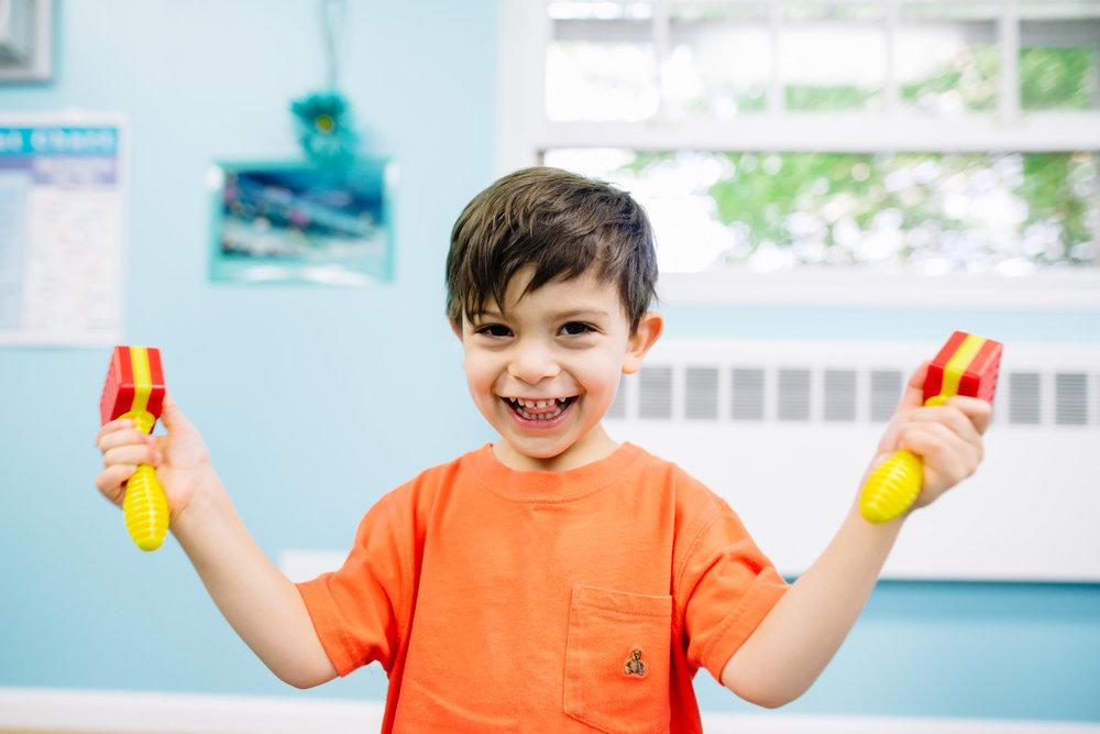 Kindermusik preschool music class - boy playing bells.jpg