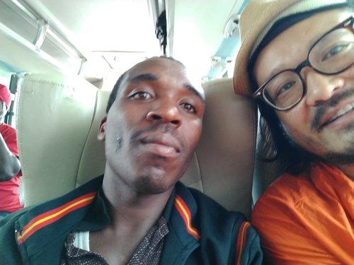 Chatting with my seatmate on a bus to Lake Kivu, Rwanda