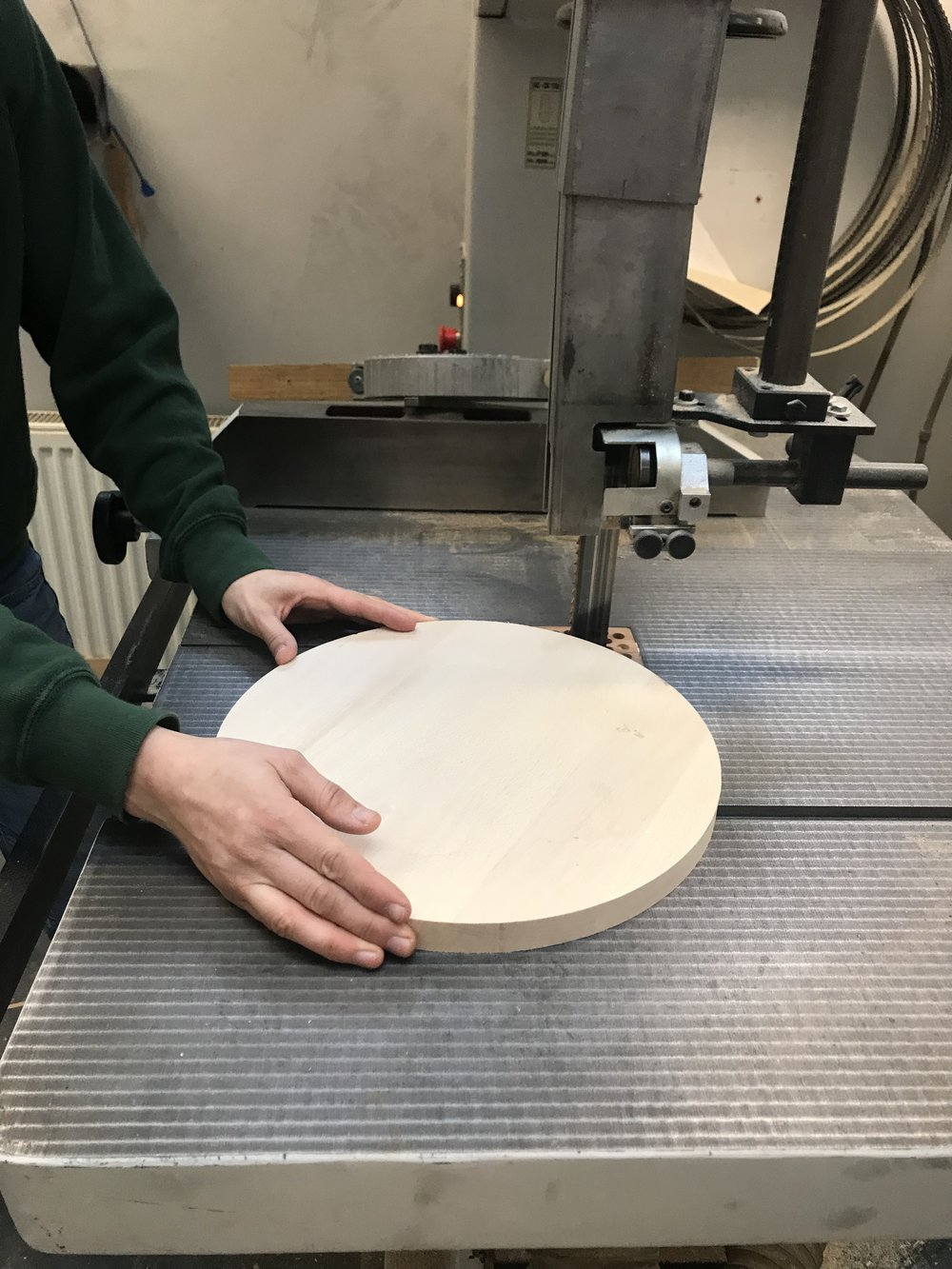 How the instructor prepared the round stool top with the bandsaw.