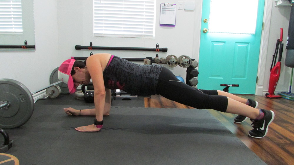 Straighten your arm to push yourself up to a straight arm plank