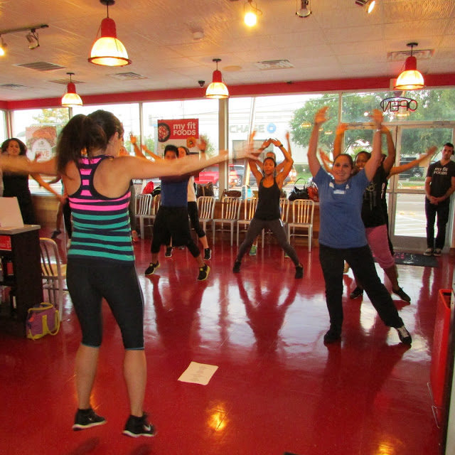 Leading a fitness class at My Fit Foods, Dallas.