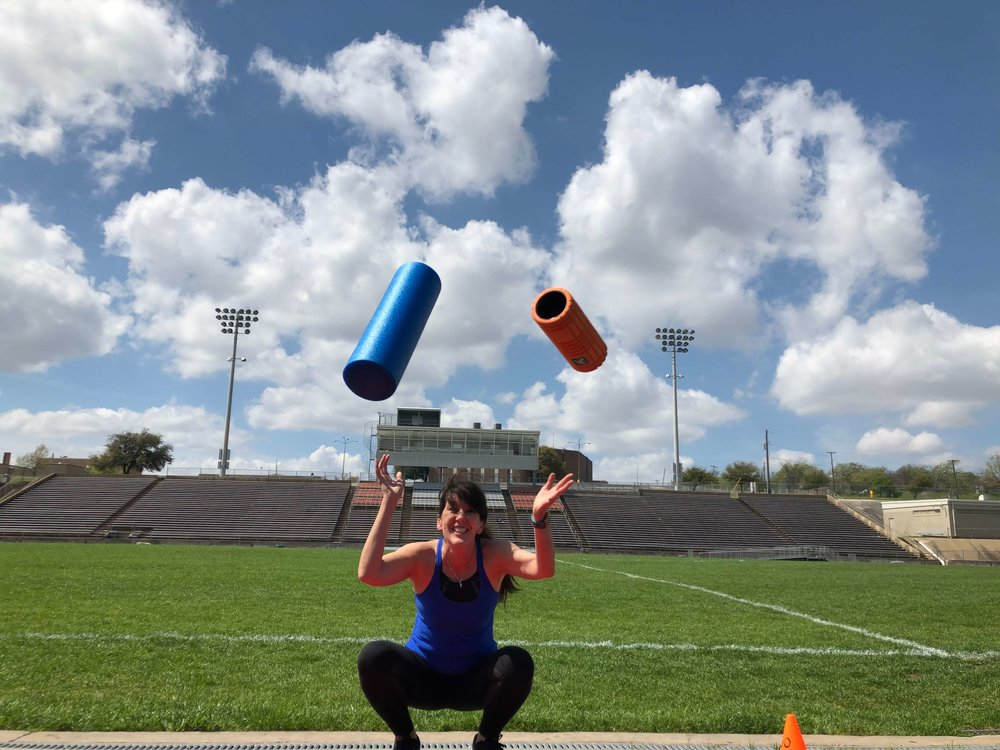 girl with foam rollers at the track