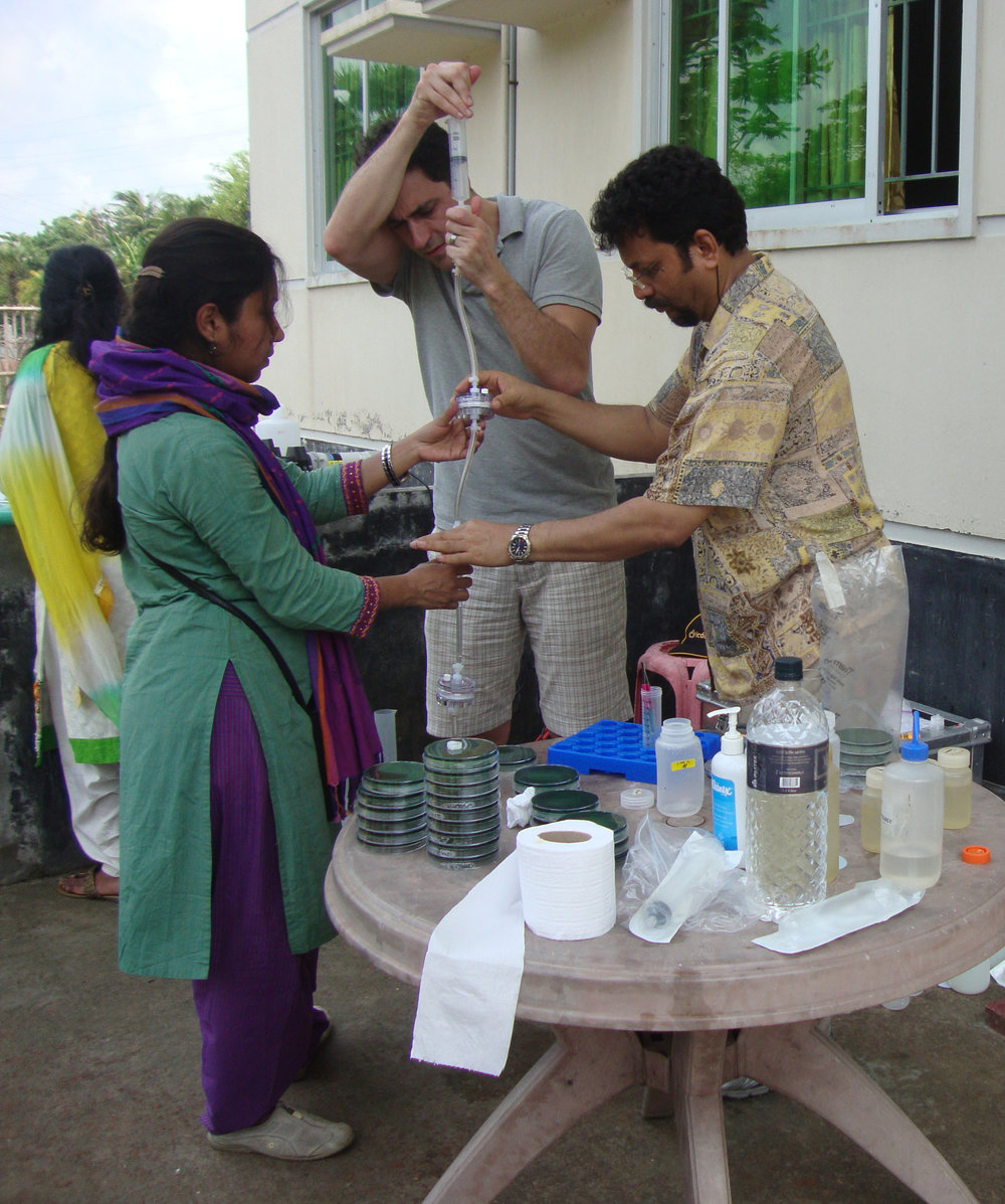 Tania, Yan, and Dr. Alam filtering water samples and isolating V. cholerae on site.