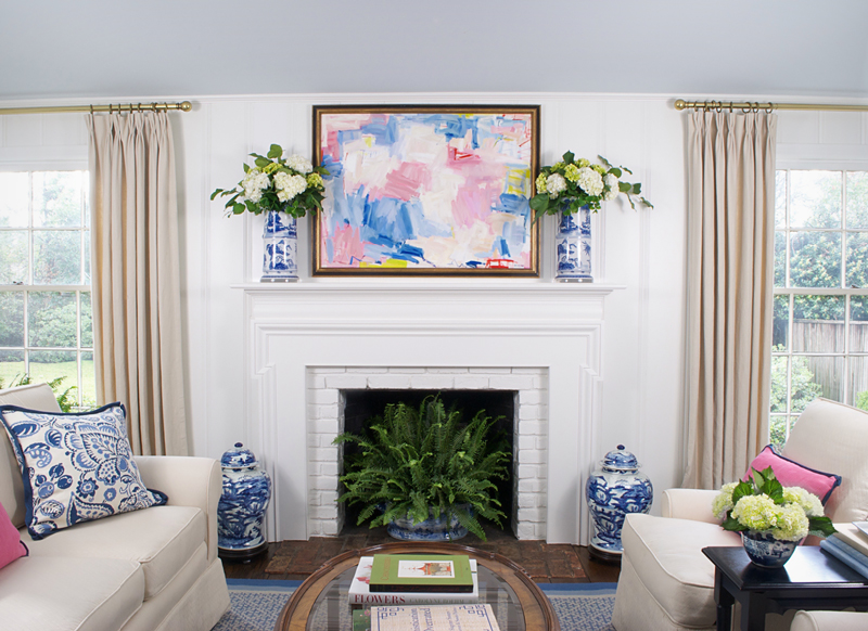 The Pink Pagoda's One Room Challenge™ family room with Reagan Geschardt painting, white hydrangeas in blue and white and Stark Carpet