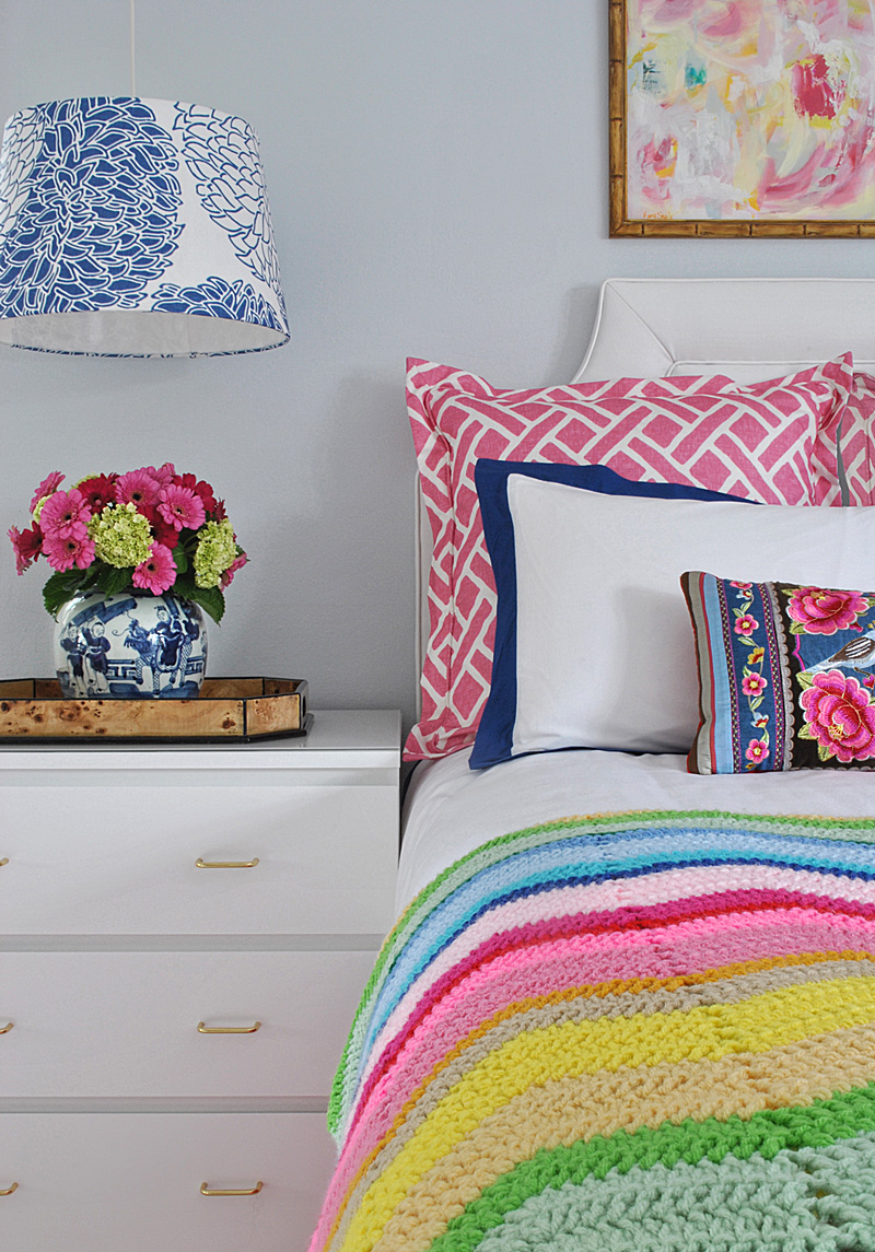 crane and canopy bedding, boho afghan, Kerry Steele painting, IKEA Malm nightstand, and blue and white Chinese melon jar with gerbera daisies and hydrangeas