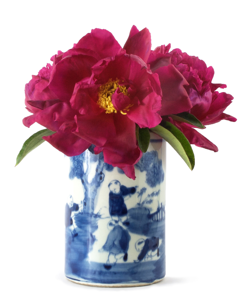 peonies in small Chinese blue and white ceramic vase