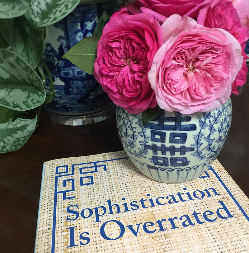 Sophistication is Overrated, The Pink Pagoda's favorite coffee table book and gift for just about everyone, with pink garden roses in a blue and white double happiness jar