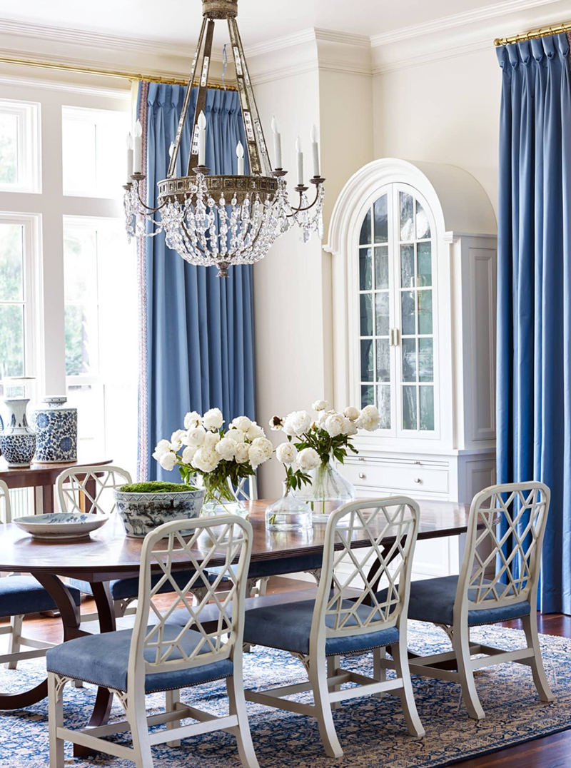 Suzanne Kasler designed dining room with blue and white, Hickory Chair chairs and Brunschwig and Fils curtain fabric.