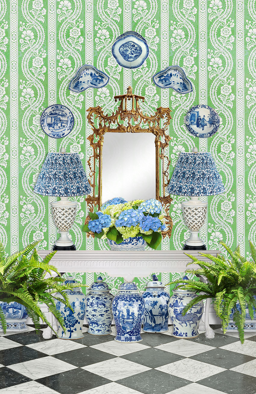 white chippendale console table with gold leaf chippendale mirror, lots of blue and white, hydrangeas and ferns