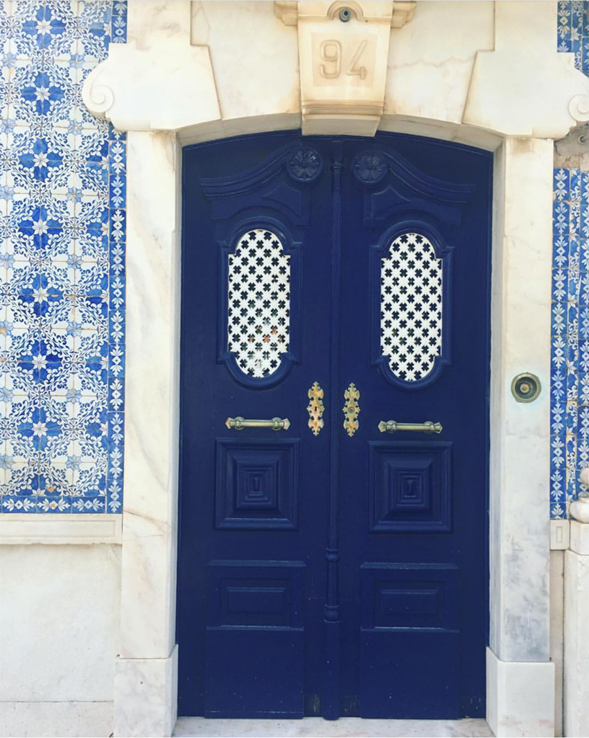 blue front door with blue and white tile