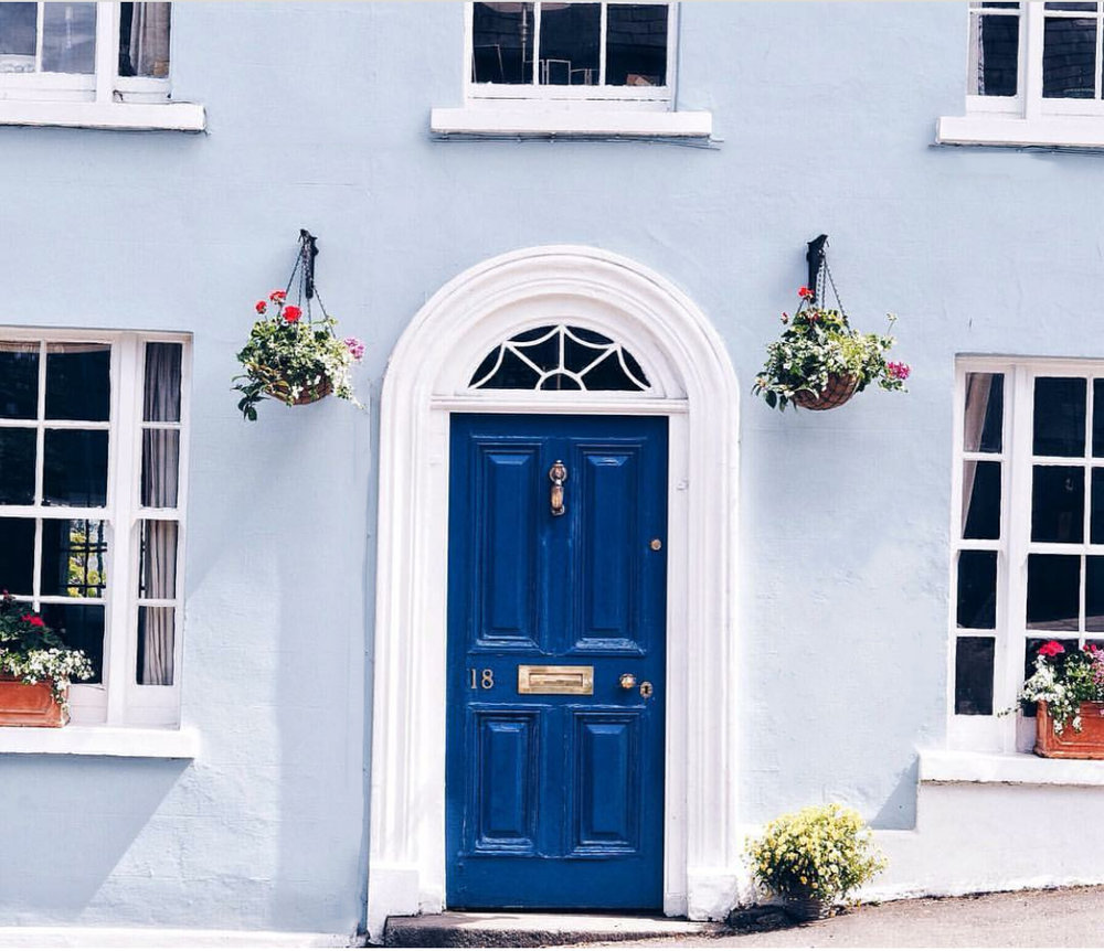 blue front door on light blue painted house