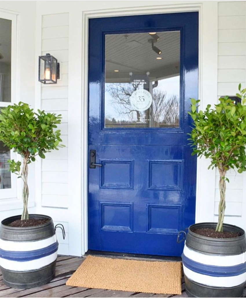 blue front door with DIY planters