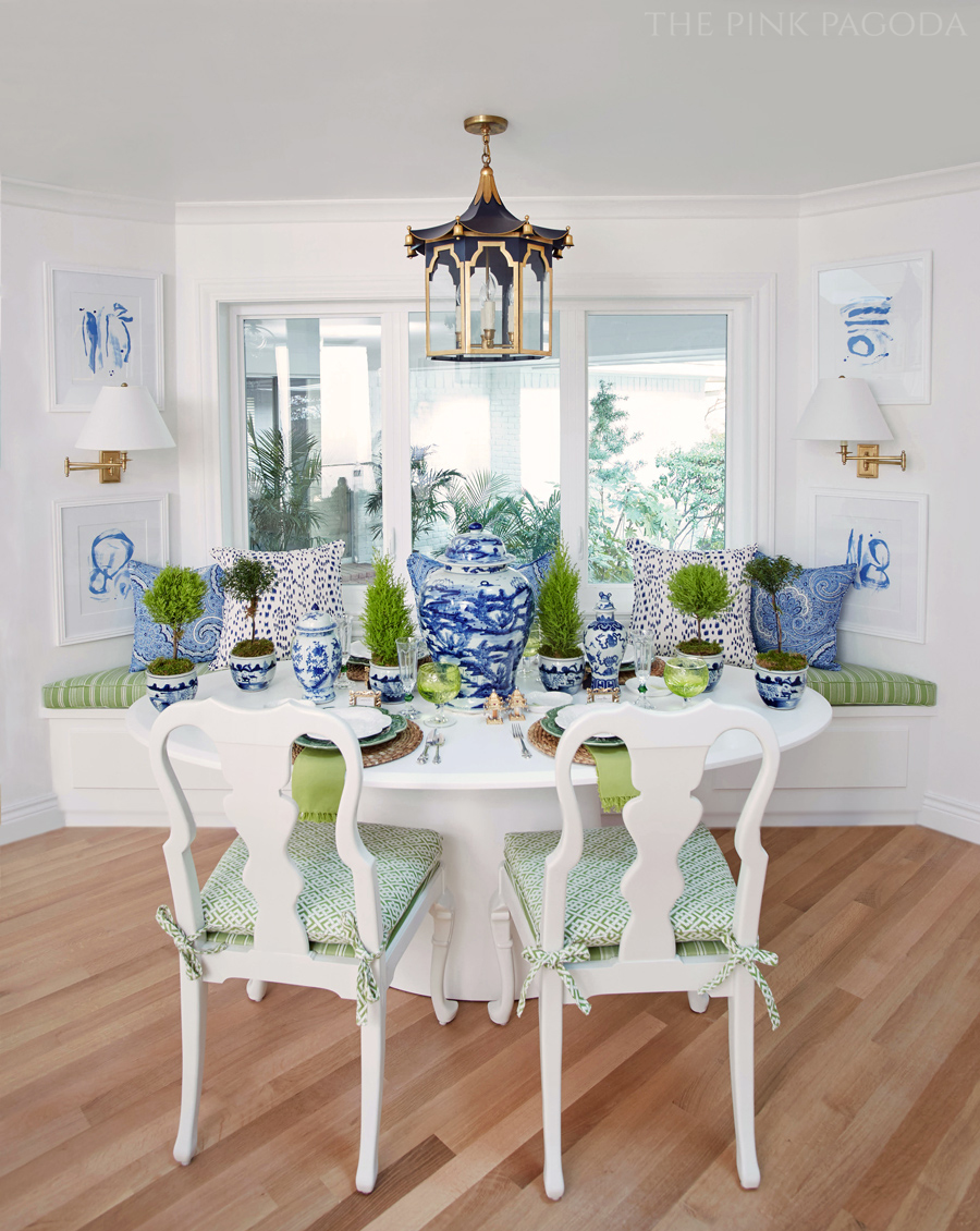 Banquette dining for The Pink Pagoda's fall 2017 One Room Challenge™ with a Coleen and Company pagoda lantern, lemon cypress topiaries, and lots of blue and white.