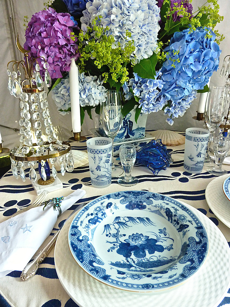 Classic tabletop with lots of blue and white and colorful hydrangeas.