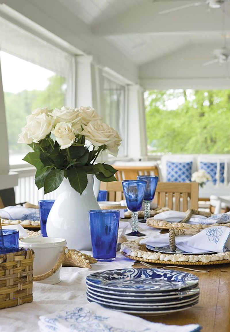 Coastal outdoor table with lots of gorgeous blue and white.