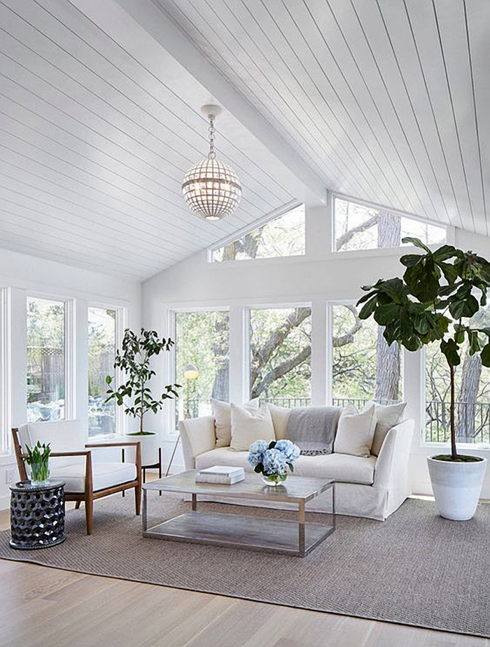 Single pane windows in a sunroom with shiplap.