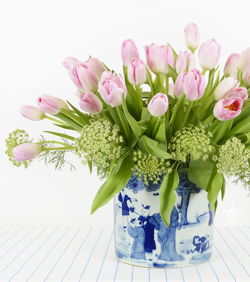 Perfect flowers for spring:  Pink tulips in a blue and white planter