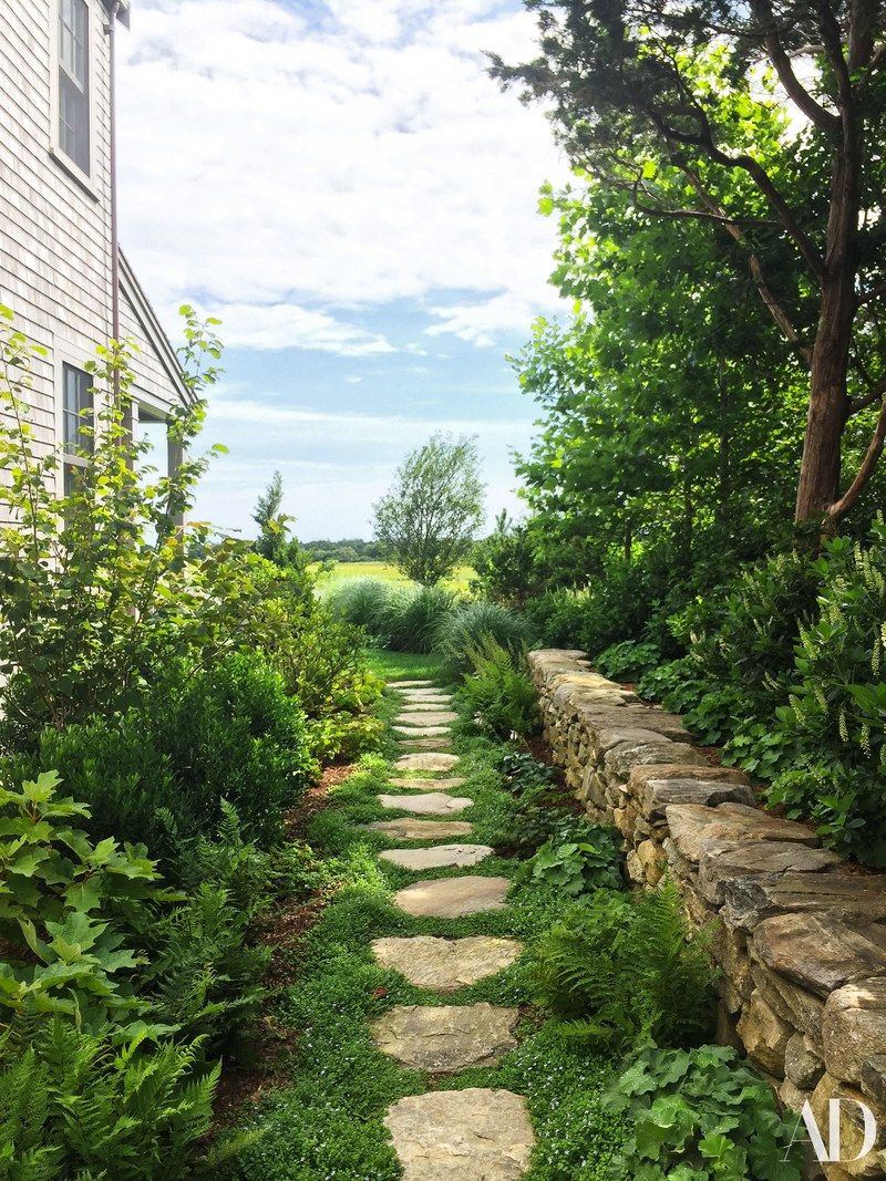 Stepping stones on the side of the charming Nantucket home featured in the June 2018 issue of AD.
