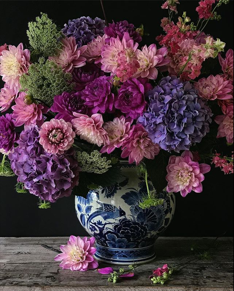 Natasja Sadi, from Cake Atelier Amsterdam, creates amazing floral arrangements usually using blue and white vases and jars.  This one features hydrangea and dahlias.