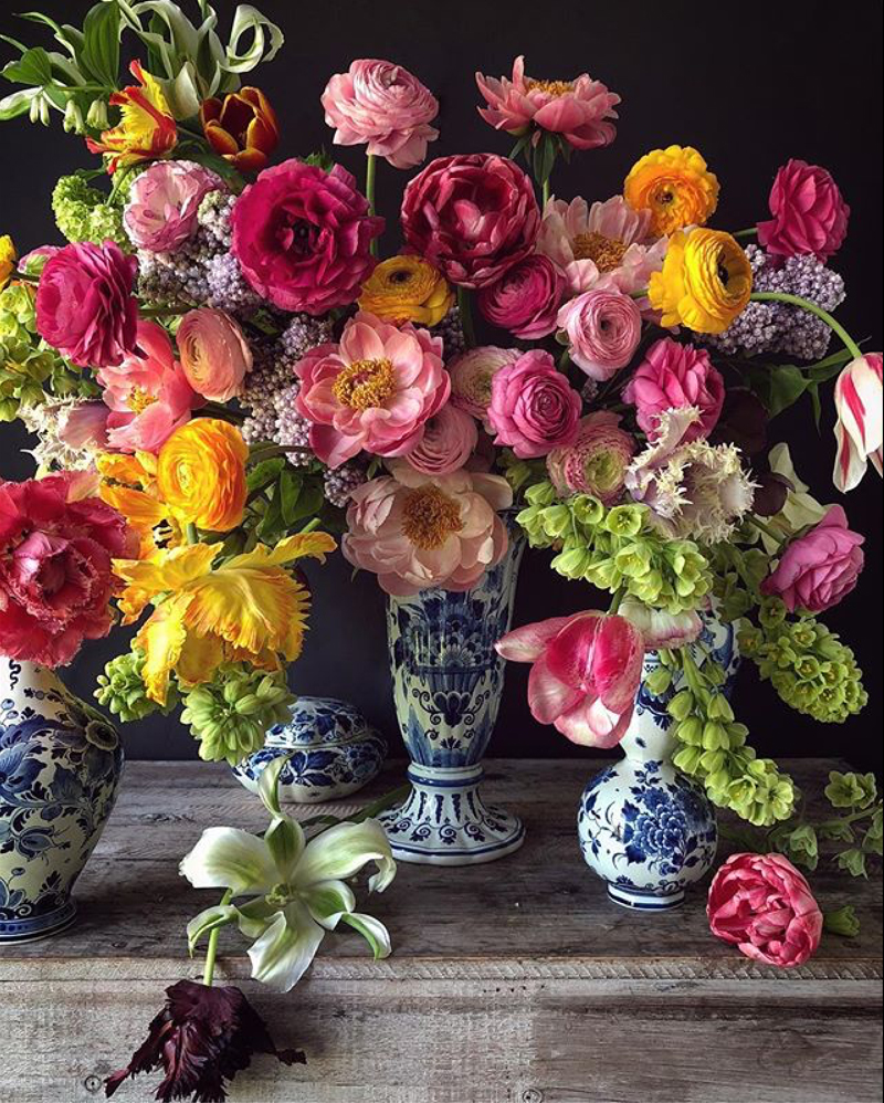 Natasja Sadi, from Cake Atelier Amsterdam, creates amazing floral arrangements usually using blue and white vases and jars.  This one features tulips, ranunculus, peonies, and roses.