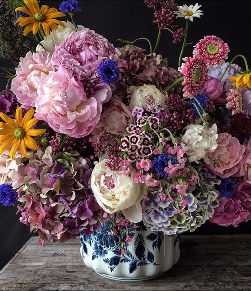 Natasja Sadi, from Cake Atelier Amsterdam, creates amazing floral arrangements usually using blue and white vases and jars.  This one features peonies, hydrangeas, and daisies.