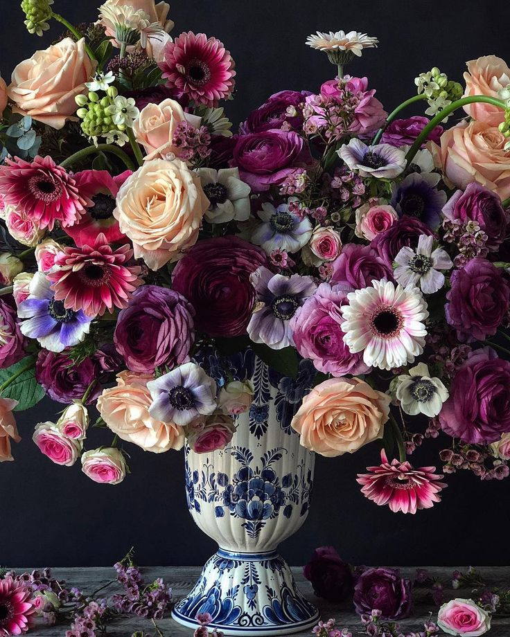 Natasja Sadi, from Cake Atelier Amsterdam, creates amazing floral arrangements usually using blue and white vases and jars.  This one features roses, rununculus, anemones, and gerbera daisies.