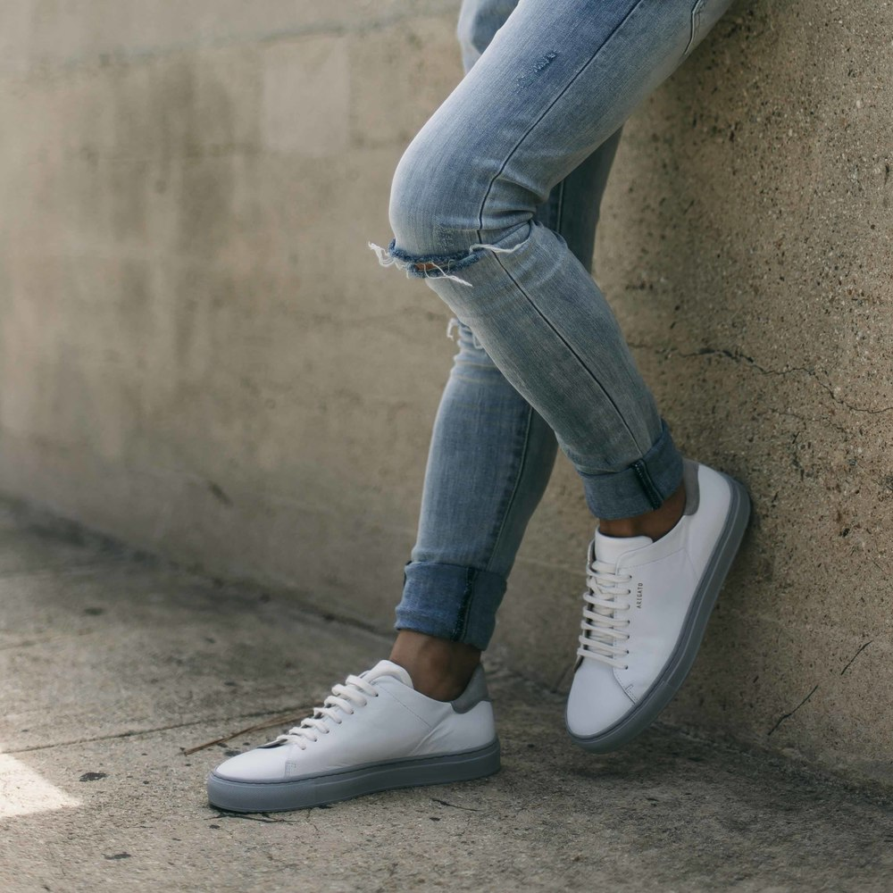 H&M  distressed jeans ,   Axel Arigato  Clean 90s sneakers